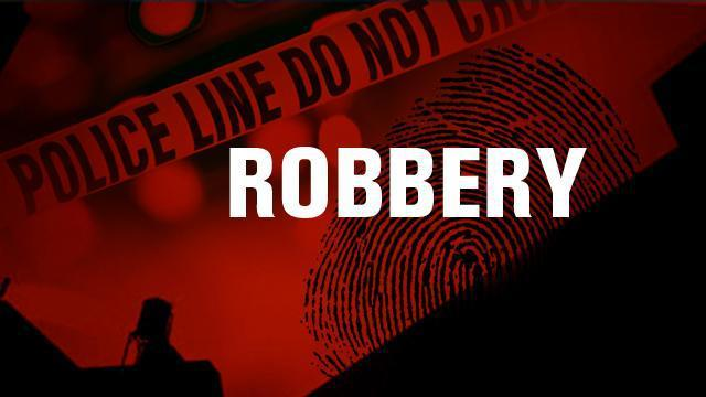 Convenience Store Robbed by Armed Suspect